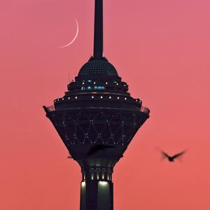A New Moon Above the Milad Telecommunication Tower by Babak Tafreshi