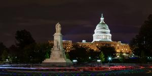 A Night Bike Tour Leaves Light Tracks Close to the Capitol Building by Babak Tafreshi