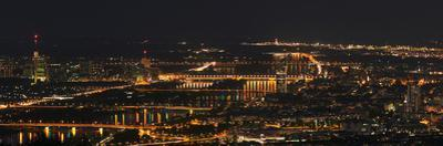 A Panoramic View of Vienna, Austria at Night by Babak Tafreshi