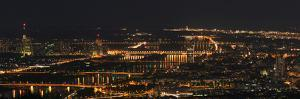 A Panoramic View of Vienna, Austria at Night by Babak Tafreshi