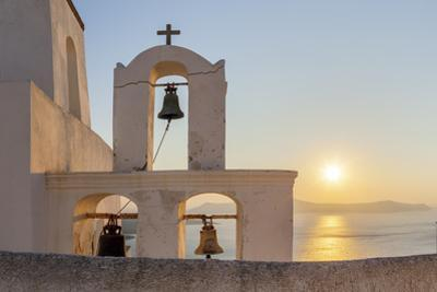 A Summer Sunset on the Mediterranean Island of Santorini, with a Historic Church and a Bell Tower by Babak Tafreshi