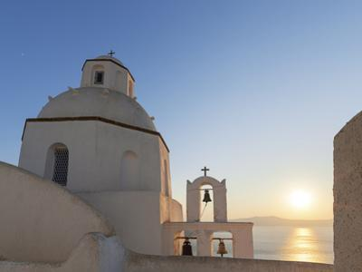 A Summer Sunset on the Mediterranean Island of Santorini, with a Historic Church and a Bell Tower