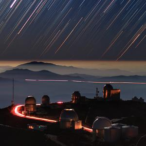 A Time-Exposure Image of the Setting Stars in a Moonlit Night in Form of Colorful Star Trails by Babak Tafreshi