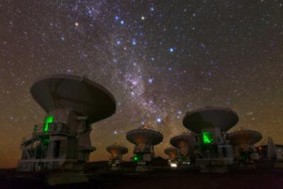 ALMA radio telescopes, 5000 meters high on Andes, observe the southern sky. by Babak Tafreshi