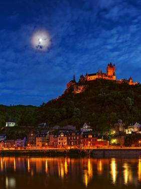 An Atmospheric Corona Circles the Moon Above the Imperial Castle of Cochem by Babak Tafreshi