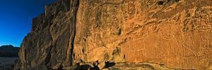 Ancient Petroglyphs in the Atacama Desert's Rainbow Valley by Babak Tafreshi