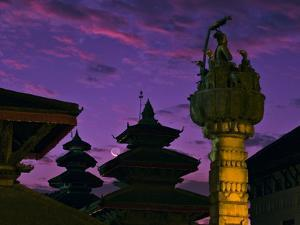 As Dawn Colors the Sky, the Thin Crescent Moon Rises over a Complex of Temples and Monuments by Babak Tafreshi