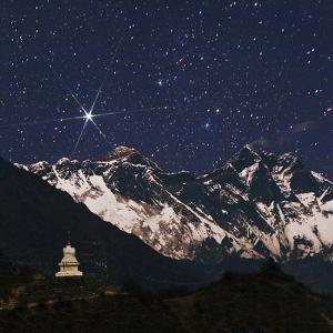 Bright Star Capella over Mount Everest. on the Right Is Mount Lhotse. a Stupa in the Foreground by Babak Tafreshi