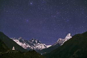 Capella in Constellation Auriga over Moonlit Mount Everest, Mount Lhotse, Ama Dablam, and a Stupa by Babak Tafreshi