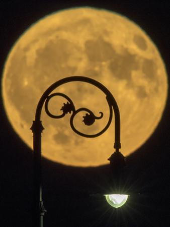 Close Up View of the Moon in the Backdrop of a Classic-Looking Streetlight by Babak Tafreshi