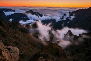 Clouds Roll over the Peaks at Caldera De Taburiente at Sunset by Babak Tafreshi