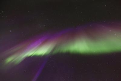 Colorful Aurora Crown or Corona During an Intense Northern Lights Activity by Babak Tafreshi