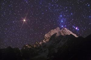 Constellation Orion and the Great Orion Nebula over Mount Thamserku by Babak Tafreshi