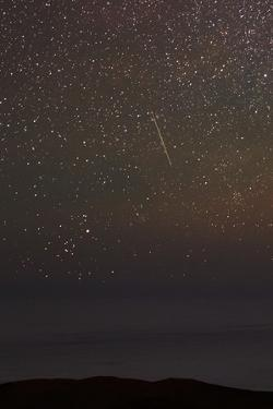 Constellation Taurus, with the V-Like Hyades Star Cluster on the Horizon, Next to a Meteor by Babak Tafreshi