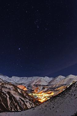 Constellations Orion and Canis Major, with Bright Star Sirius, over a Snowy Mountain Village by Babak Tafreshi