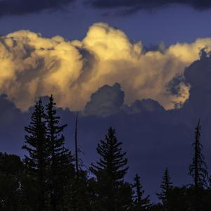 Cumulus Clouds Lit by the Setting Sun at the Grand Teton National Park by Babak Tafreshi