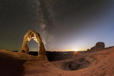 Day to Night Photo Composite of the Delicate Arch under the Milky Way by Babak Tafreshi