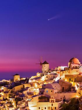 Dusk over the Aegean Sea and a Cliff-Top Town on Santorini Island. a Meteor Whizzes Overhead by Babak Tafreshi