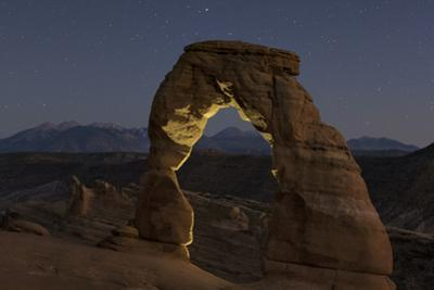 First Evening Stars Appear Above the Delicate Arch at Dusk by Babak Tafreshi