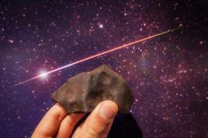 Fragment of a Metal Meteorite, and a Photograph of a Fireball Streaking Through a Star-Filled Sky by Babak Tafreshi