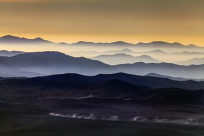 Inversion Layers in Valleys Near Atacama Desert with Dust Blown by Passing Cars on Road by Babak Tafreshi