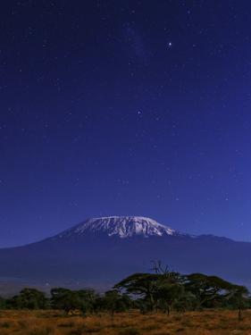 Kilimanjaro's Main Peak, Kibo, by Moonlight. the Large Magellanic Cloud Appears Above by Babak Tafreshi
