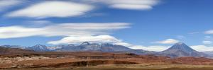 Lenticular Clouds Above Licancabur and Sairecabur Volcanic Group Bordering Chile and Bolivia by Babak Tafreshi