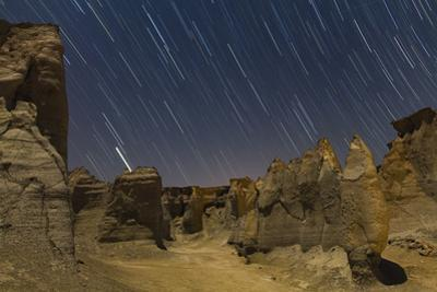 Long Exposure Image of Star Trails Above Sandstone Formations in the Valley of Stars by Babak Tafreshi