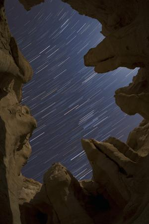 Long Exposure Image of Star Trails Above Sandstone Formations by Babak Tafreshi