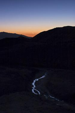 Mercury, Venus, and Crescent Moon Align in Morning Twilight over a Creek in the Great Salt Desert by Babak Tafreshi