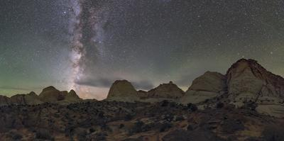 Milky Way above the Capitol Reef National Park with Navajo Sandstone dome formations. by Babak Tafreshi