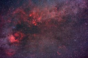 Milky Way and Neboulosity in Cygnus. the North America Nebula on the Lower Right by Babak Tafreshi