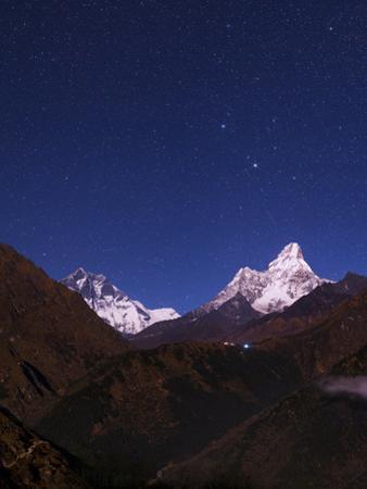Moonlit View of Mount Lhotse and Ama Dablam. Gemini's Twin Bright Stars are Overhead by Babak Tafreshi