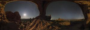 Night sky and moonlight under a giant natural arch in a 360 panorama. by Babak Tafreshi