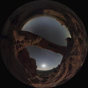 Night sky and moonlight under a giant natural arch in a fisheye view. by Babak Tafreshi