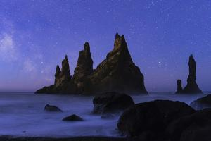 Night Sky and the Milky Way at the Break of Dawn over the Basalt Sea Stacks known as Reynisdrangar by Babak Tafreshi