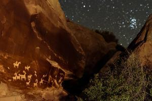 Night View of Native American Petroglyph in the Arches National Park by Babak Tafreshi