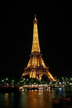 Night View of the Eiffel Tower and Colorful Lights by Babak Tafreshi