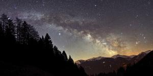 On a Starry Night the Milky Way Shows its Magnificent Beauty over Snow-Covered Austrian Alps by Babak Tafreshi