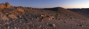 Panoramic View of Scattered Rocks on the Barren Landscape of the Atacama Desert at Dusk by Babak Tafreshi