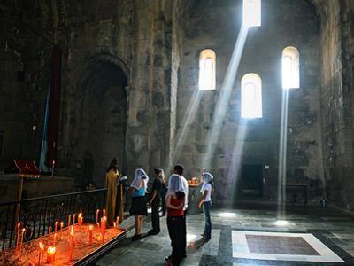 People worship in the Monastery of Tatev in southeastern Armenia. by Babak Tafreshi
