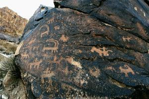 Petroglyphs About 10,000 Years Old, on the Slopes of Pyramid-Like Mount Ernan by Babak Tafreshi