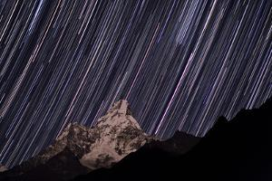 Planet Mars, the Brightest Trail, in a Multi-Exposure Digital Star Trail Image over Ama Dablam by Babak Tafreshi