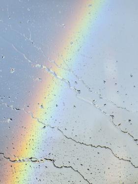 Rainbow Behind Raindrops on a Car Window by Babak Tafreshi