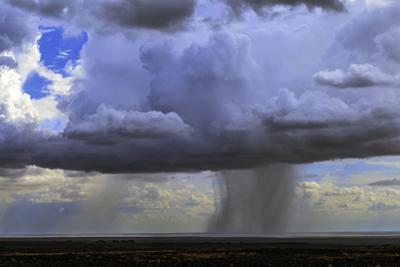 Rainclouds in a Tropical Desert in Northern Kenya by Babak Tafreshi