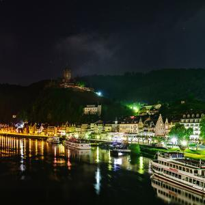 Scenic View of the Moselle River and Cochem at Night by Babak Tafreshi