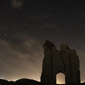 Sirius and Constellations Orion and Taurus over Ruins of the Ancient City Gate of Sar Yazd by Babak Tafreshi