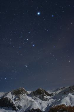 Sirius, and the Rest of Constellation Canis Major Above Snow-Covered Peaks of the Alborz Mountains by Babak Tafreshi