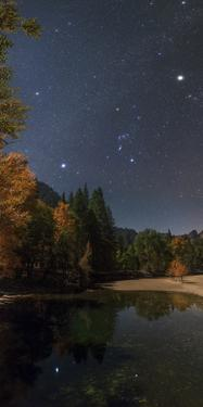 Sirius, Constellations Orion and Taurus, with Jupiter, Above the Merced River on a Moonlit Night by Babak Tafreshi