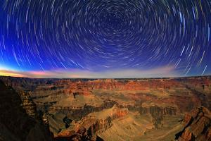 Star Trails in the Evening Sky, and Sedimentary Rock in Bright Moonlight by Babak Tafreshi